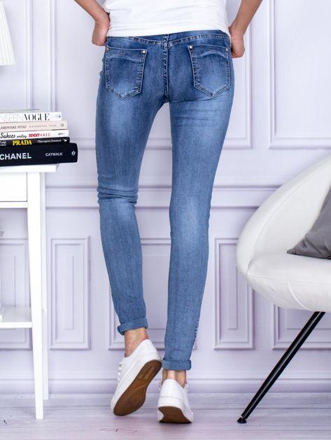 Spodnie niebieskie o kroju slim                                  zdj.                                  2