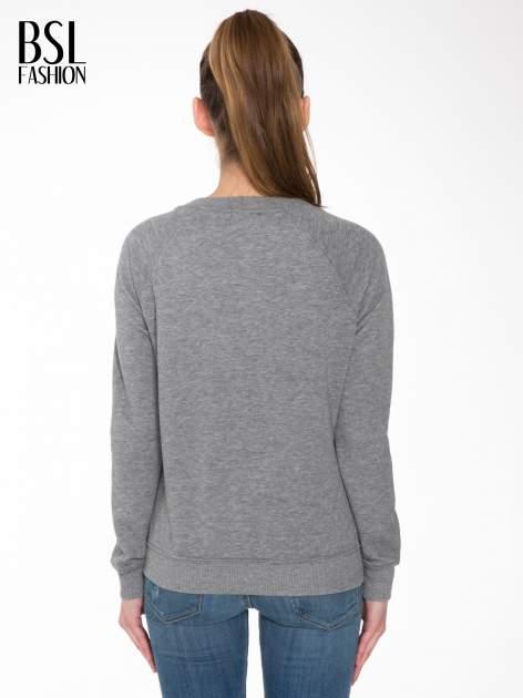 Szara bluza z reglanowymi rękawami i napisem w stylu city                                  zdj.                                  4