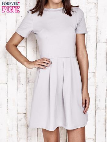 Szara sukienka dresowa wiązana na kokardę z tyłu                                  zdj.                                  1