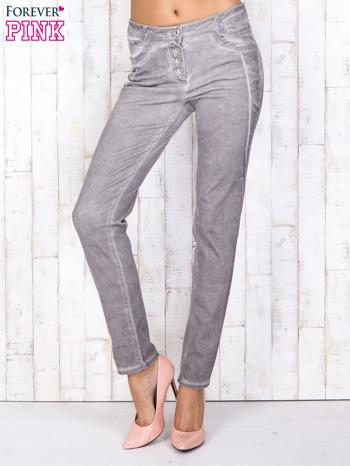Szare jeansowe spodnie skinny z brokatem i dekatyzacją                                  zdj.                                  1