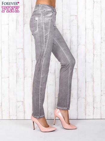 Szare jeansowe spodnie skinny z brokatem i dekatyzacją                                  zdj.                                  3
