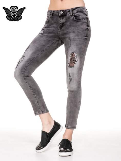 Szare spodnie skinny jeans z dziurami podszytymi koronką                                  zdj.                                  1