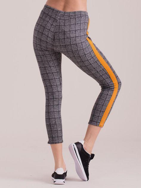 Szare spodnie we wzory z pomarańczowymi lampasami                              zdj.                              2