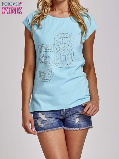 Turkusowy t-shirt z numerem 58 z dżetów