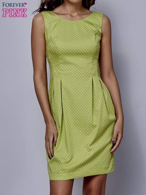 Zielona rozkloszowana sukienka w groszki