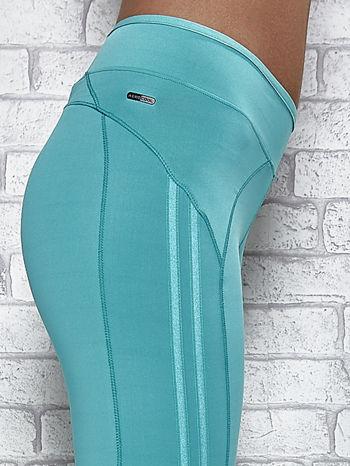 Zielone legginsy 3/4 sportowe termalne z lampasami                                  zdj.                                  5