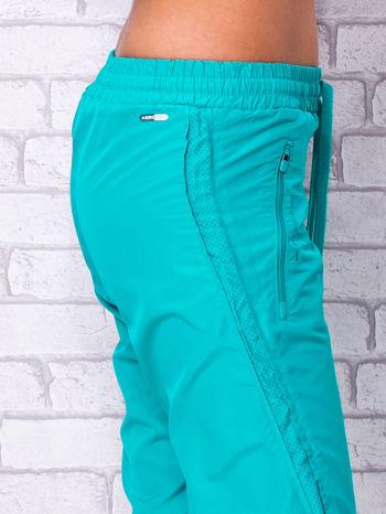 Zielone spodnie sportowe capri z siateczką                                  zdj.                                  5
