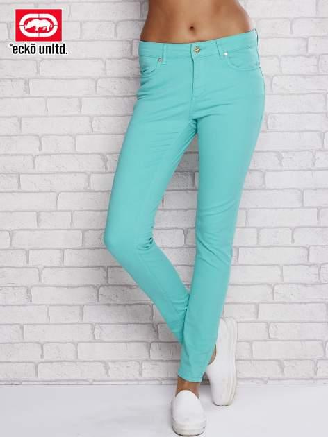 Zielone spodnie ze złotymi napami
