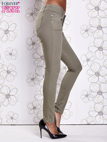 Zielone strechowe spodnie skinny z kieszeniami                                  zdj.                                  3