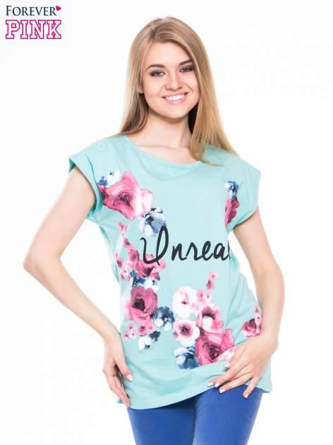 Zielony t-shirt z nadrukiem kwiatów i napisem UNREAL                                  zdj.                                  1