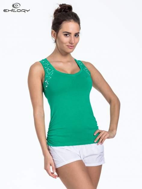 Zielony top sportowy z cekinami