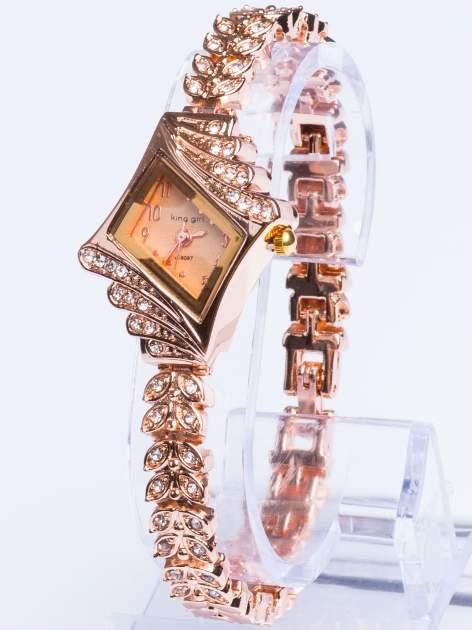 Złoty elegancki i delikatny zegarek damski z cyrkoniami                                  zdj.                                  1