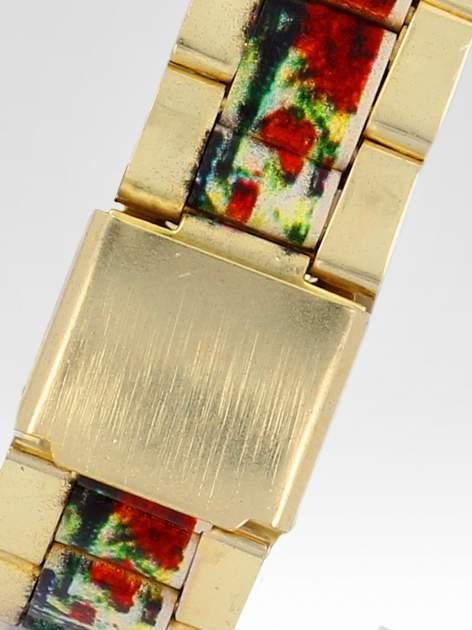 Złoty zegarek damski na bransolecie z motywem Paryża                                  zdj.                                  4