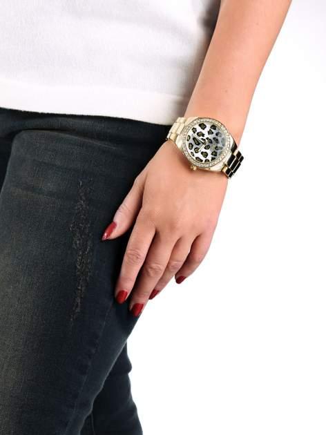 Złoty zegarek damski na bransolecie z panterkową tarczą                                  zdj.                                  3