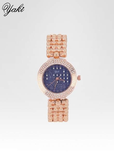 Złoty zegarek na bransolecie z grawerem wokół granatowej tarczy                                  zdj.                                  1
