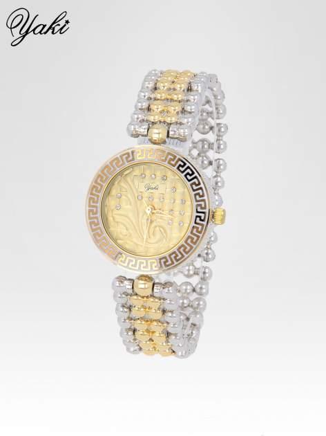 Złoty zegarek na bransolecie z grawerem wokół złotej tarczy                                  zdj.                                  2