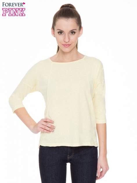 Żółta gładka bluzka z ozdobnymi przeszyciami                                  zdj.                                  1