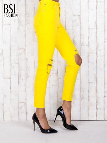 Żółte jeansowe spodnie z dziurami i kieszeniami                                  zdj.                                  3