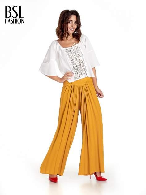 Żółte zwiewne spodnie typu culottes                                  zdj.                                  2