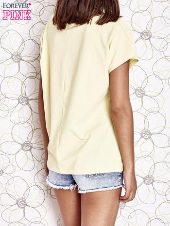 Żółty t-shirt z napisem NEED IT LOUDER                                  zdj.                                  2