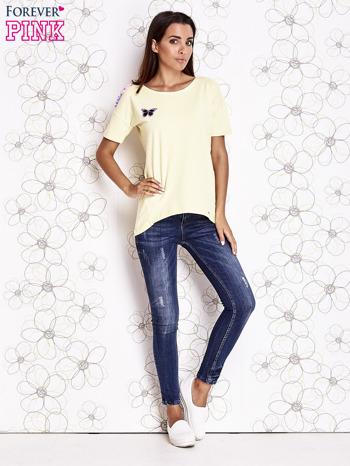 Żółty t-shirt z naszywką motyla i pomponami                                  zdj.                                  2