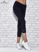 Ciemnogranatowe legginsy sportowe z patką z dżetów na dole                                  zdj.                                  1