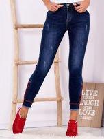 Ciemnoniebieskie jeansowe spodnie z suwakami                                  zdj.                                  1