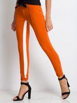 Ciemnopomarańczowe spodnie dresowe Defined                                  zdj.                                  3