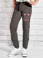 Ciemnoszare spodnie dresowe dla dziewczynki SMILE                                  zdj.                                  1