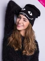 Czarna czapka beanie z oczami i z uśmiechem