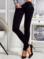 Czarne dopasowane spodnie z suwakami                                  zdj.                                  1