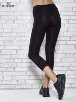 Czarne legginsy sportowe z aplikacją z dżetów na nogawkach                                  zdj.                                  3