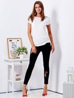 Czarne spodnie skinny z naszywkami                                  zdj.                                  4