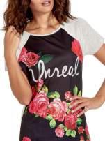 Czarnt t-shirt z kwiatowym nadrukiem i napisem UNREAL                                                                          zdj.                                                                         5