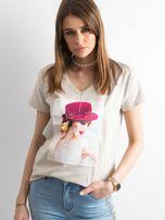 Damski beżowy t-shirt z aplikacją                                  zdj.                                  1