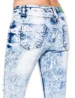 Jasnoniebieskie marmurkowe spodnie jeansowe rurki z dziurami i przetarciami                                  zdj.                                  9