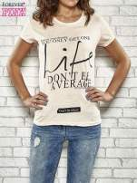 Koralowy t-shirt z napisem FOLLOW YOUR DREAMS                                  zdj.                                  1