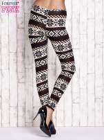 Kremowe legginsy z nadrukiem norweskim