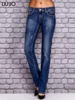 LIU JO Ciemnoniebieskie spodnie jeansowe z przetarciami                                  zdj.                                  1