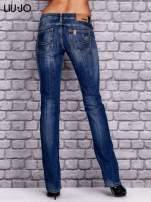 LIU JO Ciemnoniebieskie spodnie jeansowe z przetarciami                                  zdj.                                  3