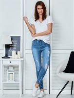 Niebieskie jeansowe spodnie skinny z koronkowymi wstawkami                                  zdj.                                  4