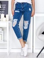 Niebieskie jeansowe spodnie z przetarciami                                  zdj.                                  1