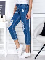 Niebieskie jeansowe spodnie z przetarciami                                  zdj.                                  3