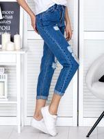 Niebieskie jeansowe spodnie z przetarciami                                  zdj.                                  5