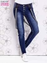Niebieskie przecierane spodnie jeansowe z szelkami                                                                          zdj.                                                                         1