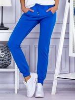 Niebieskie spodnie dresowe z kieszonką z przodu                                  zdj.                                  1