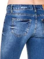Niebieskie spodnie jeans 7/8 z dziurami i przetarciami                                  zdj.                                  9