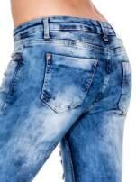 Niebieskie spodnie jeansowe dzwony z rozdarciami cut out                                  zdj.                                  7