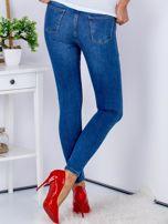 Niebieskie spodnie jeansowe skinny z przetarciami                                  zdj.                                  2