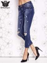Niebieskie spodnie trash jeans z cieniowaniem                                  zdj.                                  1